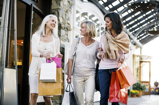 Photo of 3 ladies walking through a covered shopping street